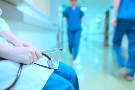 Tired doctor in hospital hall. Standard-Bild