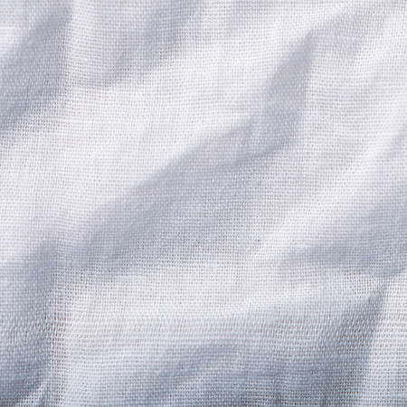 beige background: Tissue with uneven folded surface macro background photo