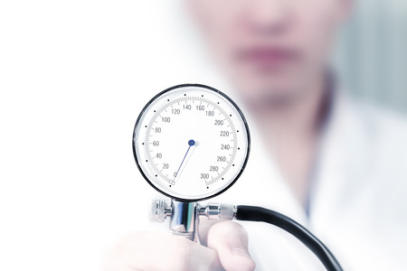 hypotension: Device for measuring blood pressure in the female doctors hand