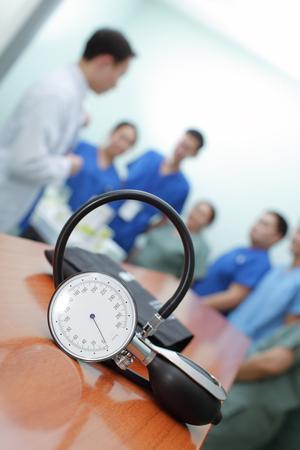 sphygmomanometer: Concept the hospital routine work. Sphygmomanometer on background of briefings doctors