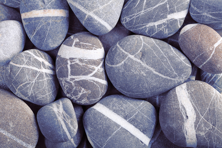 smooth stones: Stack of smooth stones with white stripes