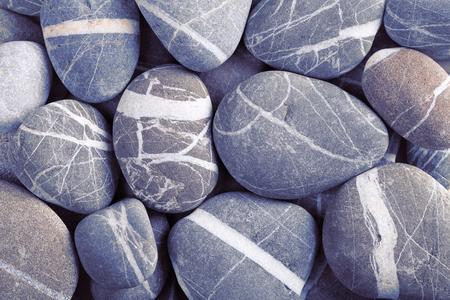 white stones: Stack of smooth stones with white stripes