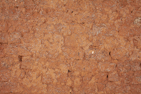 pise: Adobe wall of old village house.