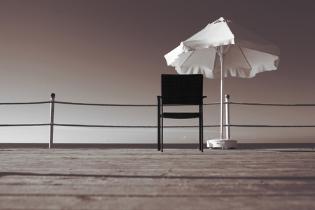 behold: Lonely armchair on a wooden pier near the sea