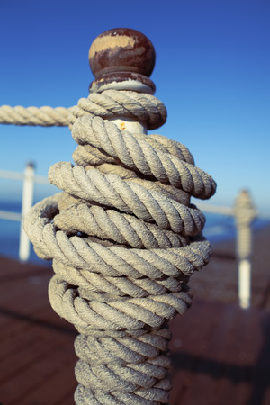 mooring: Mooring rope tied to a bollard on the dock.