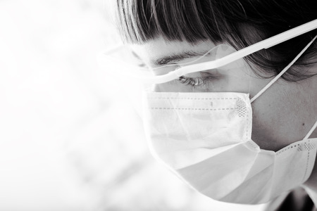 laboratorian: Portrait of a female medical worker in monochrome. Stock Photo