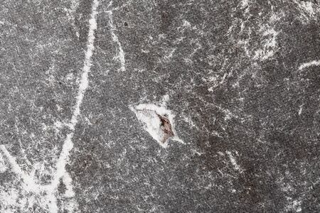 Old damaged paperboard textured background.