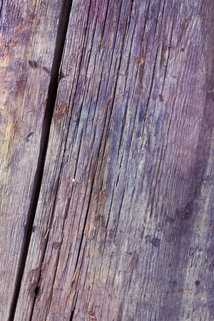 in need of space: Cracked wooden surface textured background.
