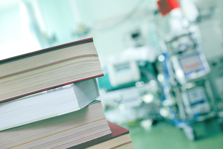 critical care: Books on the hospital background.