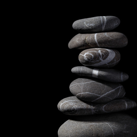 black stones: Stack of stones on the black background.