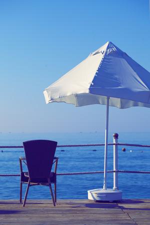 umbrela: Umbrela and armchair at the sea.
