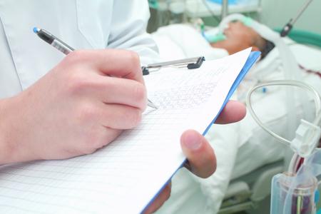 Doctor makes ward round in ICU.