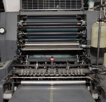 offset view: Old offset machine in printing workshop.