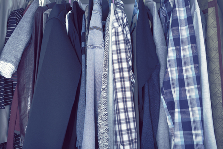 casual wear: Wardrobe with mans casual wear Stock Photo