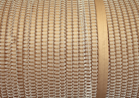 printery: Coil with white stationery spring. Stock Photo