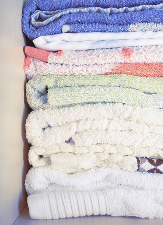 terrycloth: Shelf with stack of bath towels.