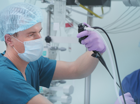 Male doctor performing endoscopy research.