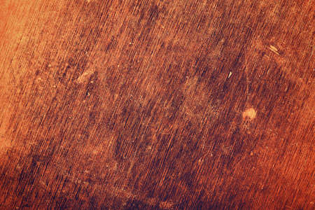 scratched: Rough scratched textured surface background.