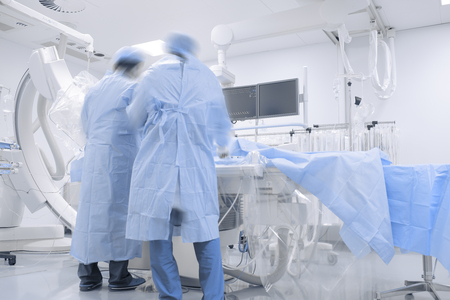 Doctors working in hospital cathlab. Archivio Fotografico