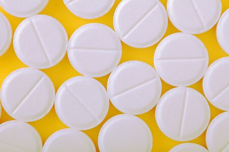 sleeping pills: Medical pills on yellow baclground.