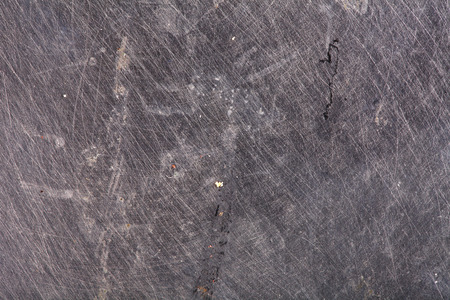 scratched: Obsolete scratched steel, textured background.