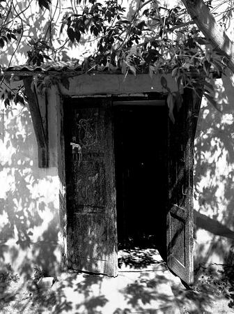 old doors: Open doors of the old house.