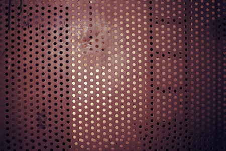 orifice: Perforated metal plate, textured background. Stock Photo