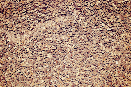 paved: Cobblestone paved wall, textured background. Stock Photo