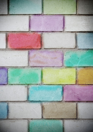 coloured: Brick wall painted with colored chalk. Stock Photo