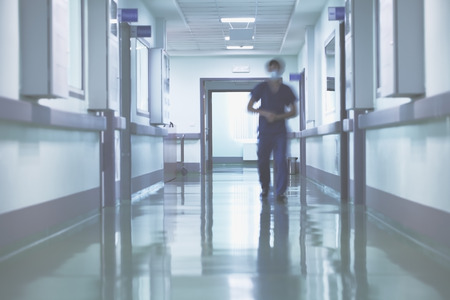 Blurred walking person in hospital hall.