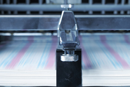 Printing on paper in the print shop. Stock Photo