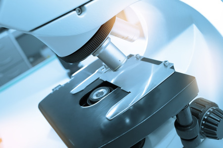 optical instrument: Microscope for professional lab assistant.