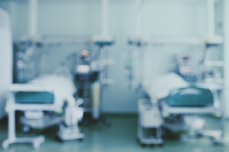intensive care unit: Two beds in intensive care unit, blurred background.