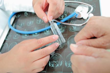 trial indoor: Doctor prescribes a medicine to a patient Stock Photo