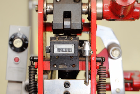 machinery space: Meter of an old printing machine.