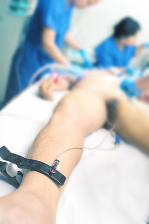 Team of doctors providing first aid to the victim in the ER