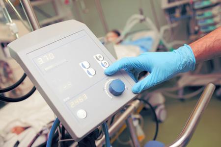 adjuster: Medical equipment adjuster in hospital ward.