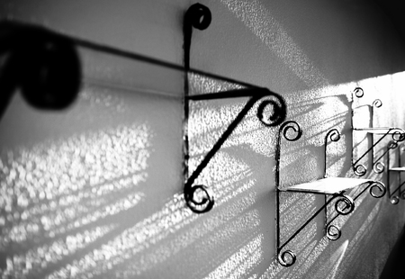 black shadows: Bizarre glare and shadows cast by an antique, black and white abstract photo.