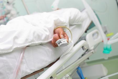 nursing unit: Oxygen saturation measurement device on the patients finger.