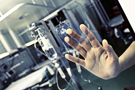 Patient in hospital pressed his hand to the glass asking help.