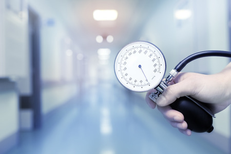 Doctor holding manometer to arterial pressure measurement.