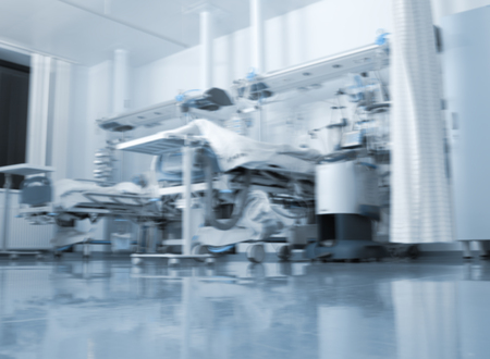 Hospital room with contemporary equipment, unfocused background.