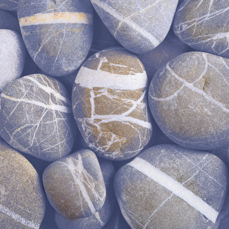 Smooth striped stones on the beach.