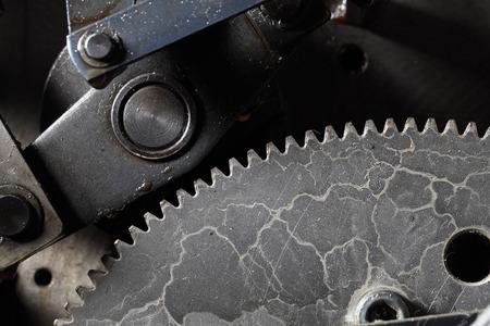 Old dirty gearwheel in work.