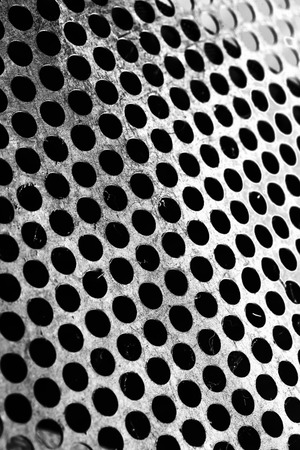Perforated metal sheet with scraped surface.