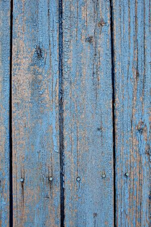 Old lath fence with peeled paint.