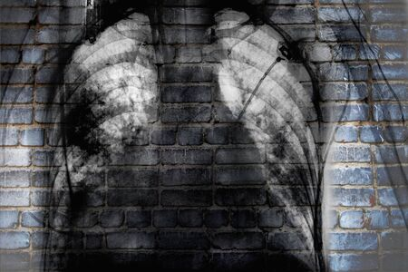 X-ray of chest on the brick wall, concept of social trouble.
