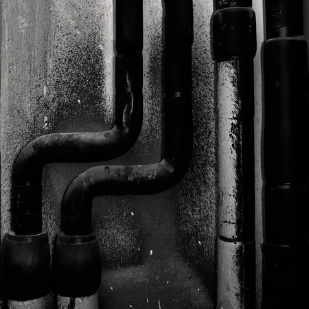 Water pipes on the painted wall background.