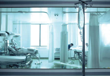 Intensive care unit ward behind the window glass.
