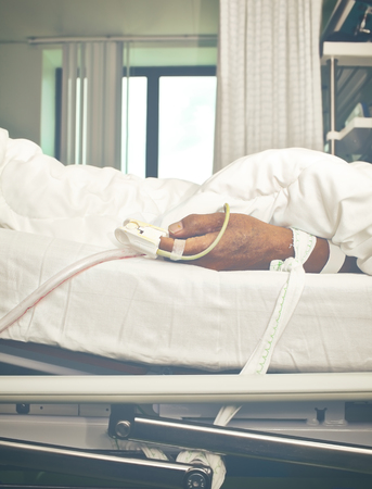critical conditions: Patients hand tied to the bed.